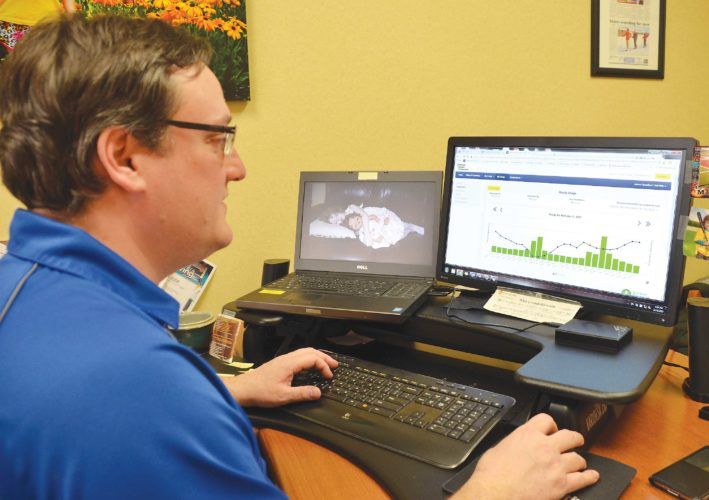 Phot by Eloise Ogden/MDN Tom Rafferty, member services and communication manager for Verendrye Electric Cooperative, explains how SmartHub, a service offered by the cooperative to its members, is available for members to track their electricity usage.