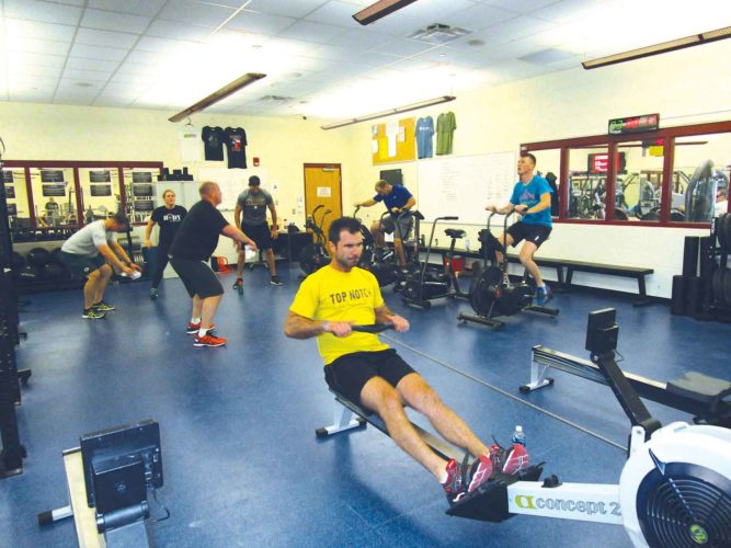 Allan Blanks/MDN  Competitors at North Plains CrossFit class participate in a Tabata workout at the Minot Family YMCA.