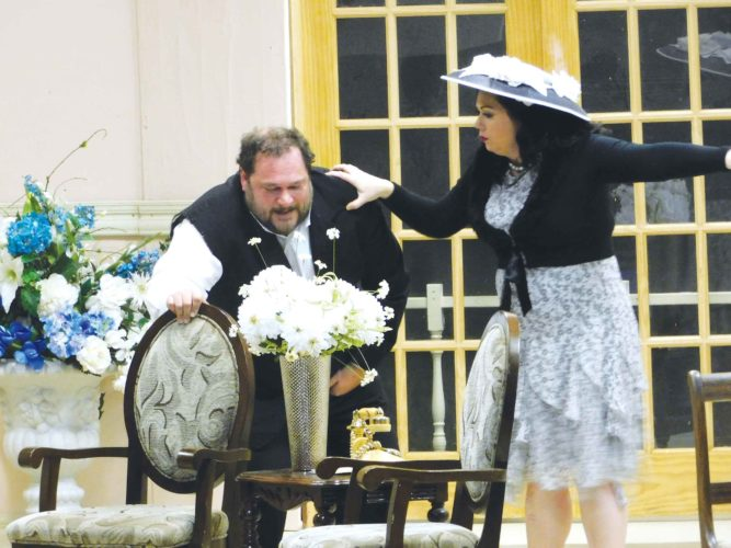 """Submitted photo Roy Hubley, played by Joe Koppinger seeks the aide of his wife, Norma Hubley, performed by Krys Zorbaugh, in the Mouse River Players production of """"Plaza Suite."""""""