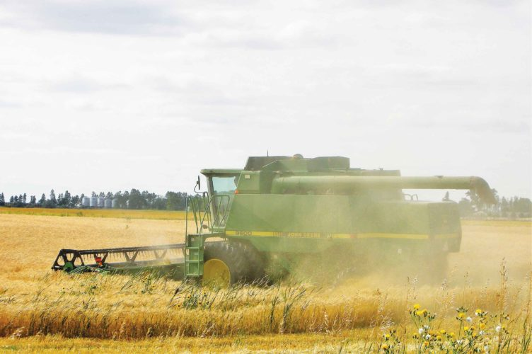 File photo A Minot-area field is harvested. Producers will be observing and participating in the debate over a new farm bill.
