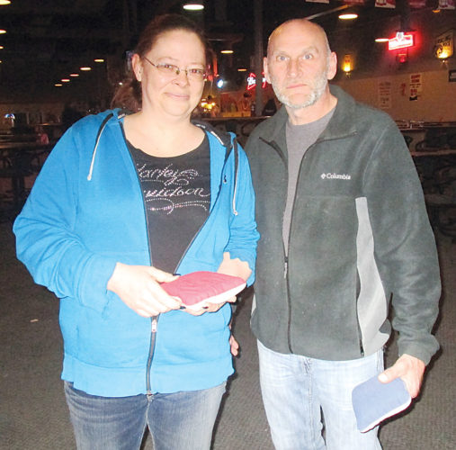 Allan Blanks/MDN  From left to right, Lynette Martin, a gaming specialist at Dae Udder Place, stands with her manager, Rick Hoff, as they prepare their Cornhole Classic.