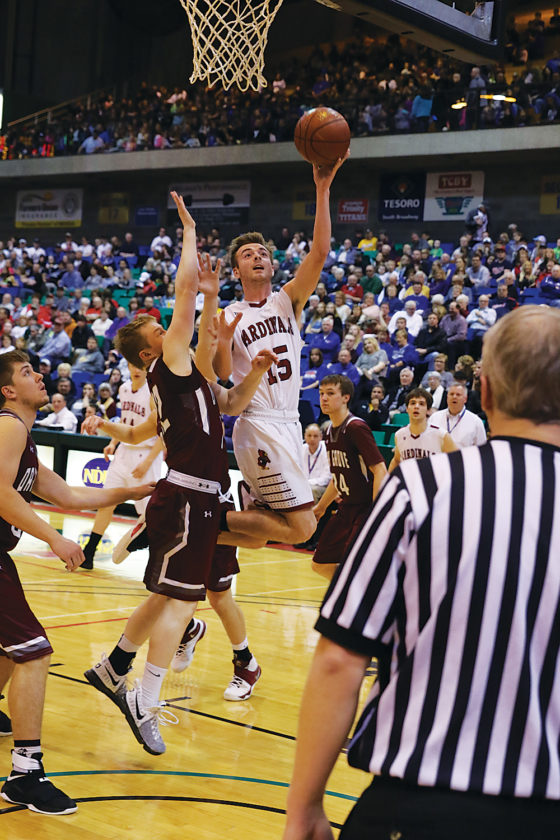 Al Christianson/Special to the Minot Daily News Ellendale's Brennen Vance (15) tries to convert a layup during the North Dakota Class B boys basketball state tournament third-place game Saturday at the MSU Dome in Minot.
