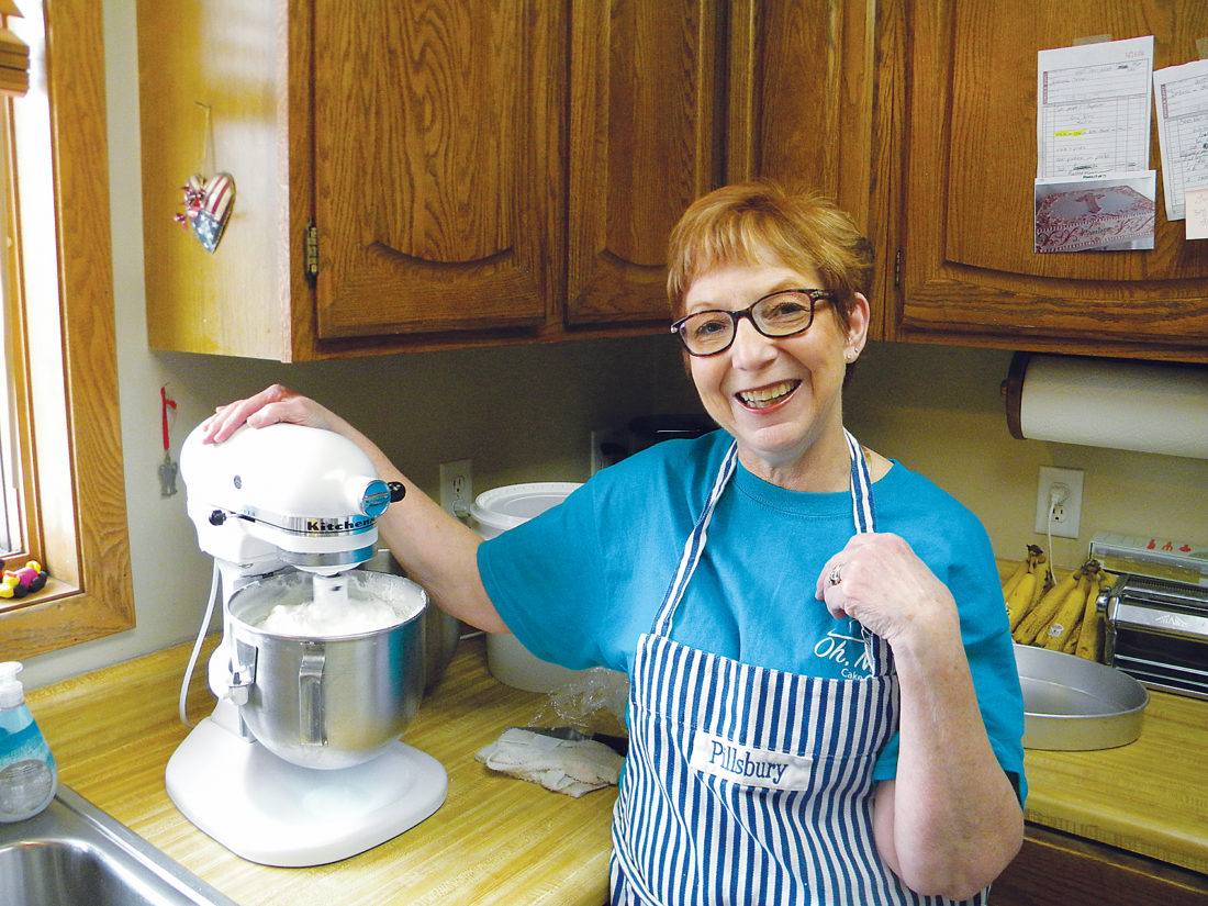 "Kent Olson/MDN Nyla Stromberg starts her magic on a cake in her home kitchen where Minot's queen of cakes struck out on her own in January, opening Oh, Nyla Cake Designs. ""This little kitchen is a very busy place,"" she said."