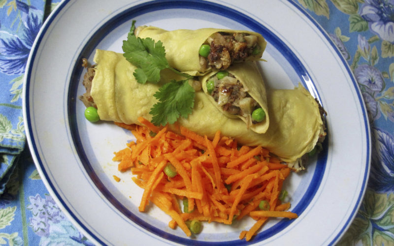 This February 2017 photo shows chickpea crepes stuffed with Indian spiced potatoes and peas in New York. This dish is from a recipe by Sara Moulton. (Sara Moulton via AP)