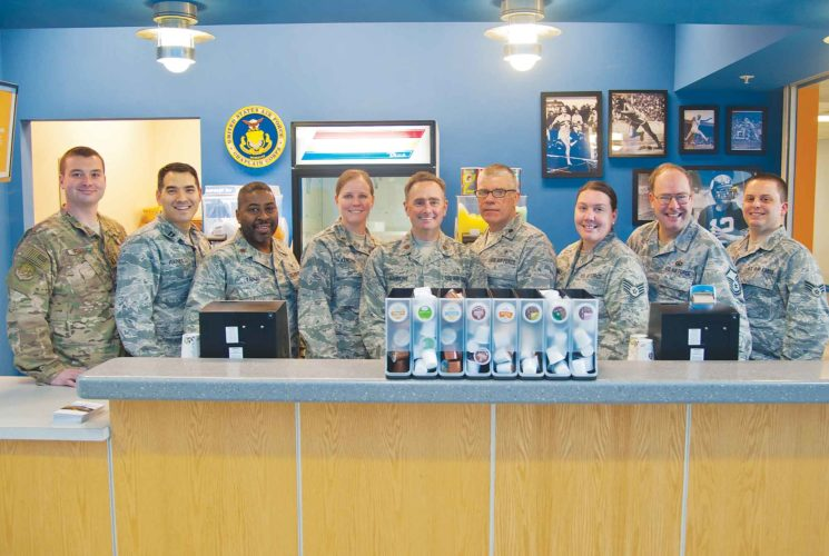 Submitted Photo The Minot chapel staff poses in their juice and coffee bar where they serve airmen free refreshments at Minot Air Force Base, March 13, shown in this photo by Senior Airman Christian Sullivan. The staff was awarded with the Charles I. Carpenter Award for being the Air Force's Outstanding Large Chapel Team.