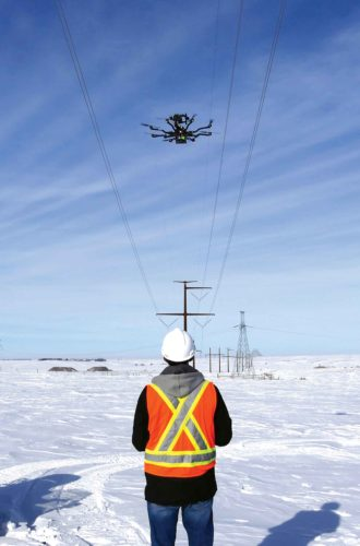 Submitted Photo  SkySkopes Chief Instructor Pilot  Cory Vinger  flies a drone during a  January power line inspection near Wilton.