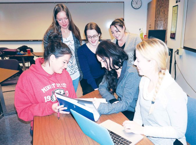 Jill Schramm/MDN  A group of nursing students at Minot State University gather in a classroom to review course material between classes April 10.