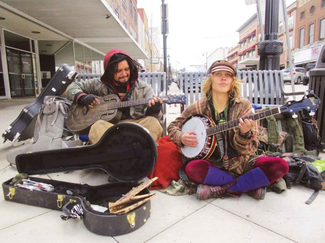 Allan Blanks/MDN  Rubberto Toez, left, and Cadiey Stressman are a singing and songwriting duo of Yeah Dawgs and the Goons. The two performers have taken a temporary vow of homelessness to spread musical messages about personal happiness and following one's passion.