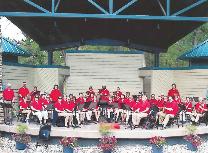 Submitted Photo   Members of the Minot City Band are shown in this photo taken at the band shell in Oak Park in Minot last year. At far left is Jerry Spitzer, who directed the band from 1983-2016 and at the far right is Joe Alme, who now directs the band.