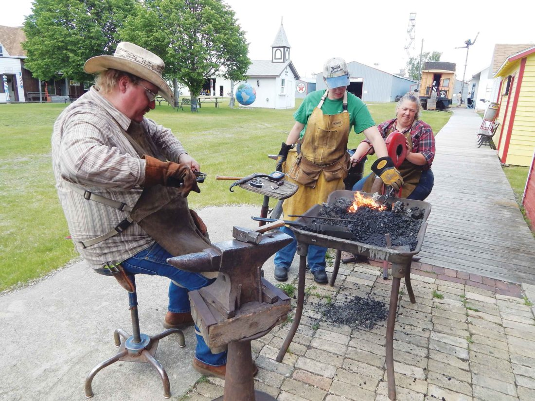 Submitted Photo Dean Hagen, Maddock, and his apprentices demonstrate blacksmithing at Prairie Village Museum during the 2015 Museum Comes Alive event.