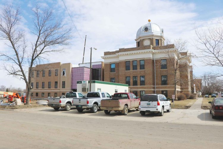 Submitted Photo This photo from the Crosby Journal shows a new addition to the Divide County Courthouse in Crosby at left of the current Courthouse in early April as construction moves toward completion.