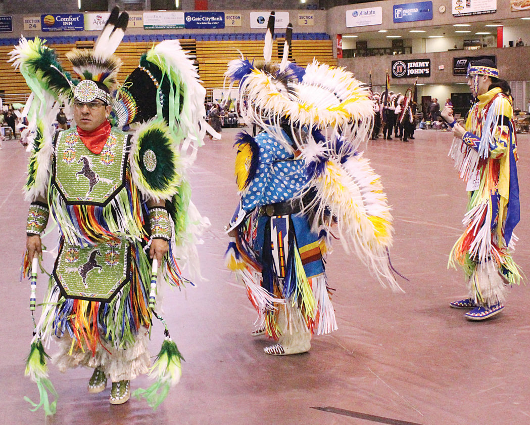 Mark Jones/MDN  Dancers perform during the Grand Entry at the MSU Dome Saturday at the annual Spring Honor Dance.