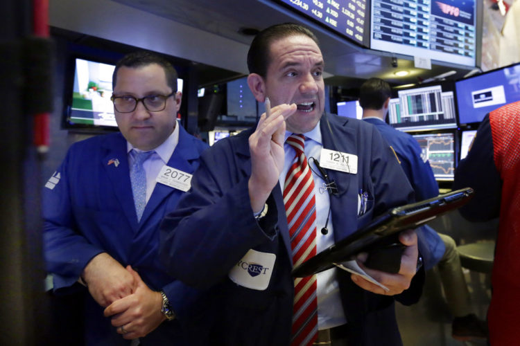Specialist Brian Fairbrother, left, and trader Tommy Kalikas work on the floor of the New York Stock Exchange, Tuesday, May 16, 2017. U.S. stock indexes were little changed in early trading Tuesday, a day after the market closed at record highs. (AP Photo/Richard Drew)