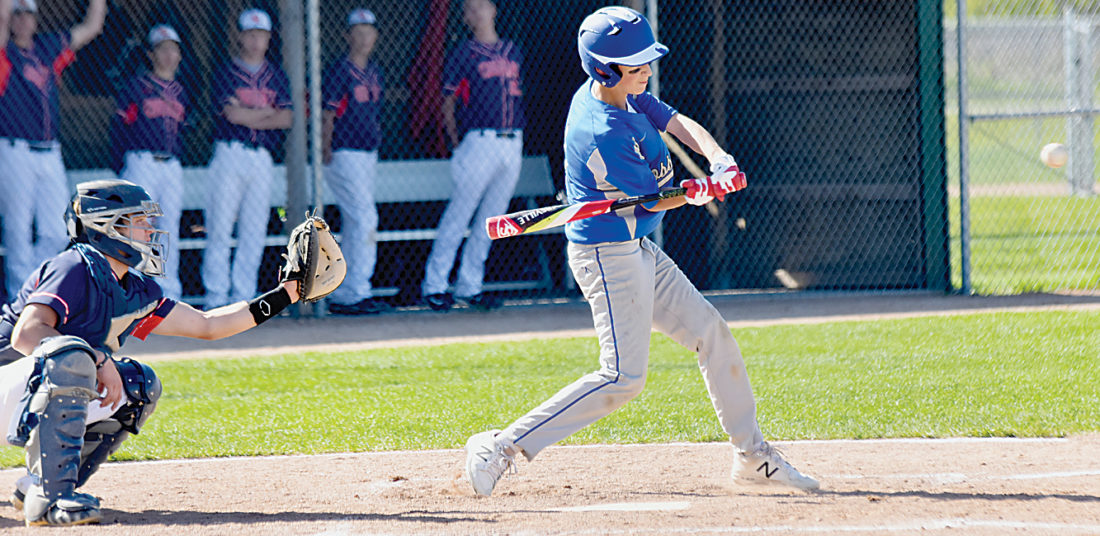 Garrick Hodge/MDN  Max/Garrison/White Shield's Dawson Wimer swings at a pitch while Central McLean catcher Blake Anderson prepares to receive the pitch behind home plate during the Region 6 play-in game Thursday at Jack Hoeven Park in Minot. M/G/WS defeated Central McLean 5-3 in the Region 6 play-in game Thursday.