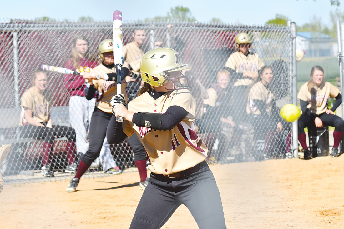 Garrick Hodge/MDN  Minot High's Rylee Terrel (11) swings at a pitch during a girls high school softball game Thursday at the South Hill softball complex in Minot.