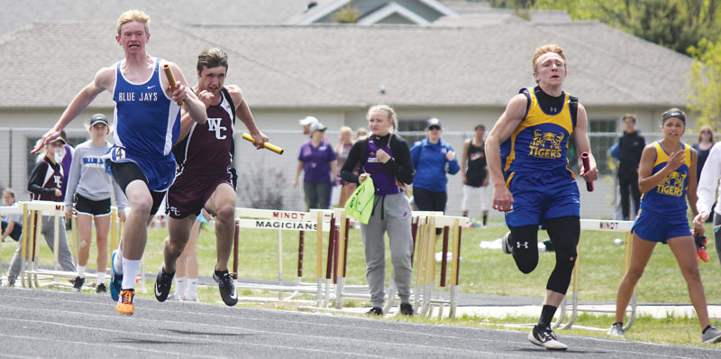Alex Eisen/MDN In the final leg of the boys 4x100, Trenton-Trinity Christian's Austin Smith (right) leads Stanley's Wyatt Hanson (left) and Watford City's Connor Dennis to the line Saturday in Minot.