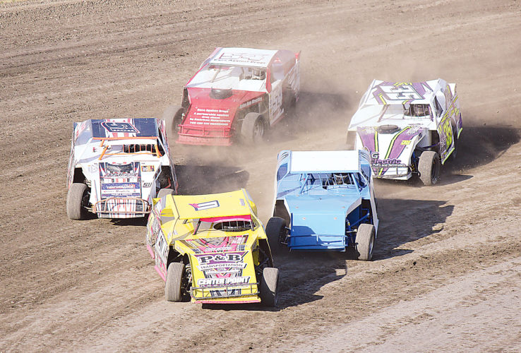 AP Photo Robby Rosselli (yellow) brings Heat 2 of the IMCA Sports Mods to the green flag Sunday evening at Nodak Speedway in Minot. Rosselli won the heat and placed second in the main feature.