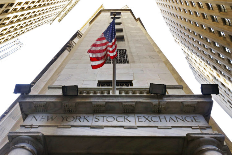 In this Friday, Nov. 13, 2015, file photo, the American flag flies above the Wall Street entrance to the New York Stock Exchange. U.S. stocks are broadly higher early Monday, May 22, 2017, as the market bounces back from a turbulent week. Defense contractors are making some of the largest gains and materials makers, technology and consumer-focused companies are all rising. Ford is up after it replaced CEO Mark Fields, while chemicals maker Huntsman is rising after it agreed to combine with Swiss competitor Clariant. (AP Photo/Richard Drew, File)