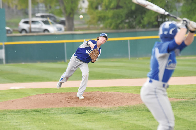 Garrick Hodge/MDN  Surrey pitcher Mason Dunn fires a pitch during a loser-out game at the Region 6 baseball tournament Monday at Corbett Field in Minot.