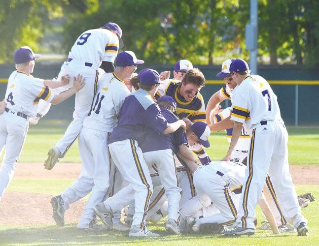 Garrick Hodge/MDN  Bishop Ryan players celebrate after the final out of the Region 6 baseball championship Tuesday at Corbett Field in Minot. The Lions punched their first ticket to the Class B state tournament since 2013 with a 6-0 win over Velva/Drake-Anamoose/Sawyer.