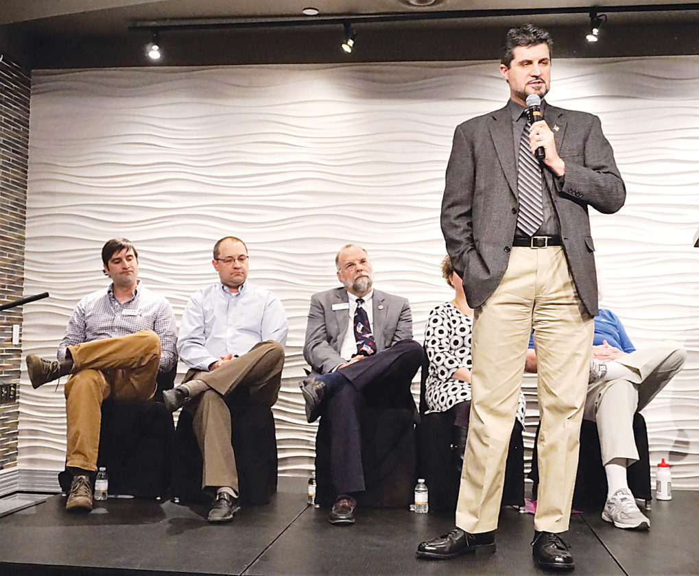Jill Schramm/MDN Council candidate Shaun Sipma speaks at a forum Wednesday as, from left, Shannon Straight, Josh Wolsky, Mark Jantzer, Lisa Olson and Stephan Podrygula listen.