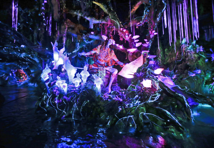 "In this April 29, 2017, file photo, the Na'vi Shaman of Songs celebrates with music in Na'vi River Journey ride at Pandora-World of Avatar land attraction in Disney's Animal Kingdom theme park at Walt Disney World in Lake Buena Vista, Fla. The 12-acre land, inspired by the ""Avatar"" movie, opens in Florida at the end of May at Walt Disney World's Animal Kingdom. It cost a half-billion dollars. (AP Photo/John Raoux, File)"