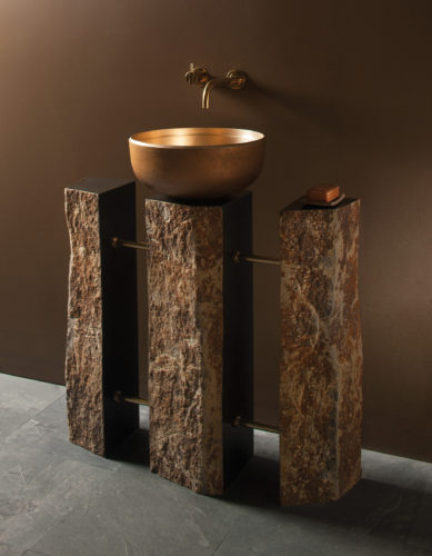 This photo provided by Stone Forest shows their Triple Basalt pedestal sink. Basalt pillars make for a unique pedestal sink base. These basalt columns from Stone Forest have both polished facets and the natural surface, creating a unique organic contemporary fixture that can be topped with a vessel basin. Configurations can be one, two or three pillars, joined by brass or nickel finished tubing. (Stone Forest via AP)