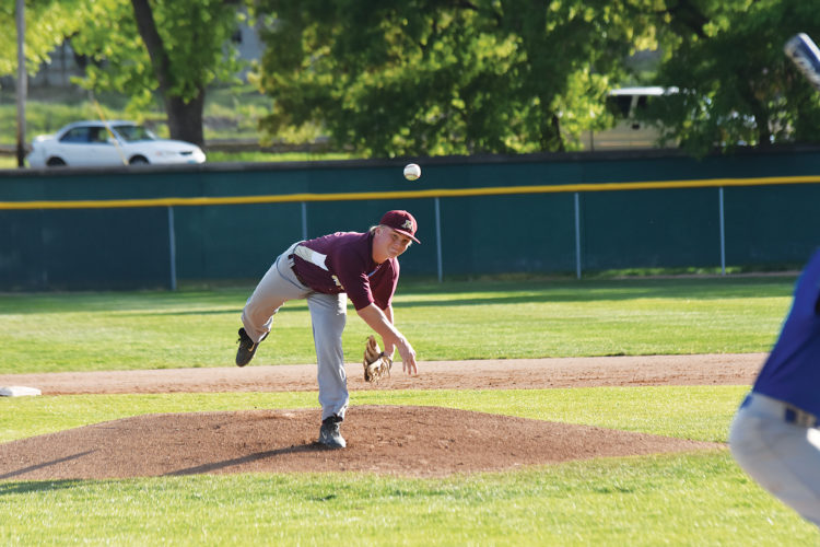 Garrick Hodge/MDN Minot High pitcher Creighton Rudolph delivers a pitch to home plate during a West Region baseball tournament game.