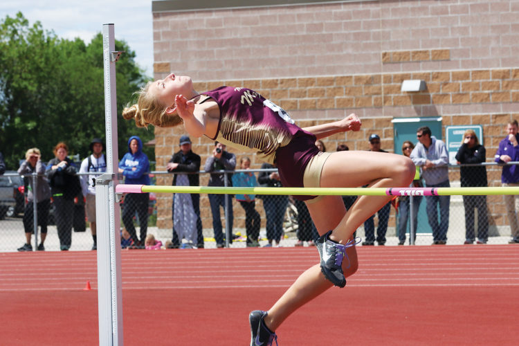 Photo special to MDN/Al Christianson Minot High freshman Allie Nelson clears the bar in the Class A high jump. She placed third in the state with a jump of 5-feet, four inches.