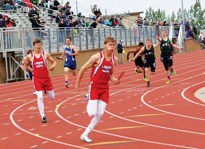 Photo special to MDN/Al Christianson Des Lacs-Burlington/Lewis & Clark junior Josh Knutson takes the baton from sophomore Tommy Burke in the Class B boys 4x200 relay. DLB-LC won its heat and bolstered the fastest time in the preliminaries (1:30.35).