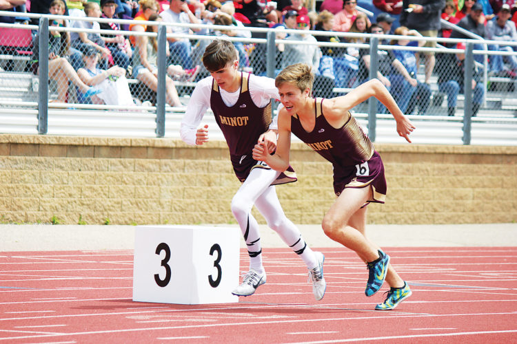 Alex Eisen/MDN Minot High's Gabe Hegstad (6) and Carson Tofteland take off from the start line in the Class A boys 1,600 meter final. Hegstad placed fifth with a time of 4:30.03.