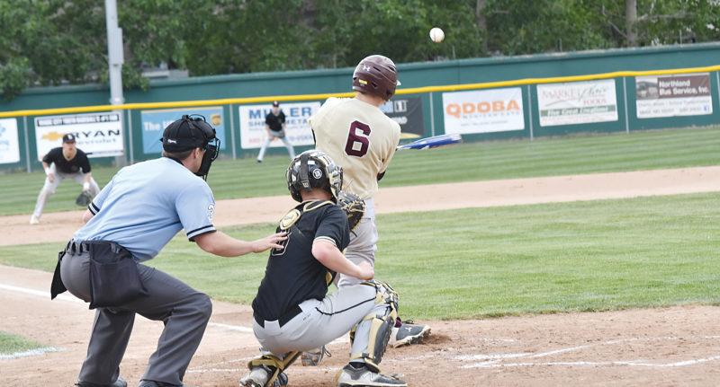 Garrick Hodge/MDN Minot High's Alex Schimke hits a line drive during the West Region baseball tournament Saturday at Corbett Field in Minot.