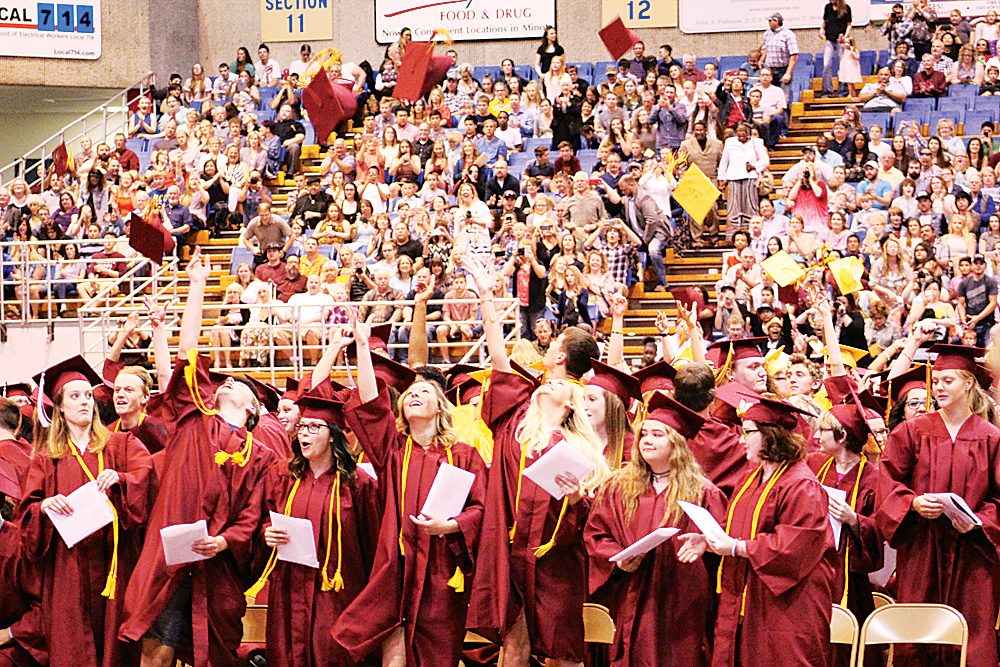 Mark Jones/MDN Members of the Minot High School Class of 2017 throw their caps into the air at the conclusion of Sunday's commencement exercises at the Minot State Dome.