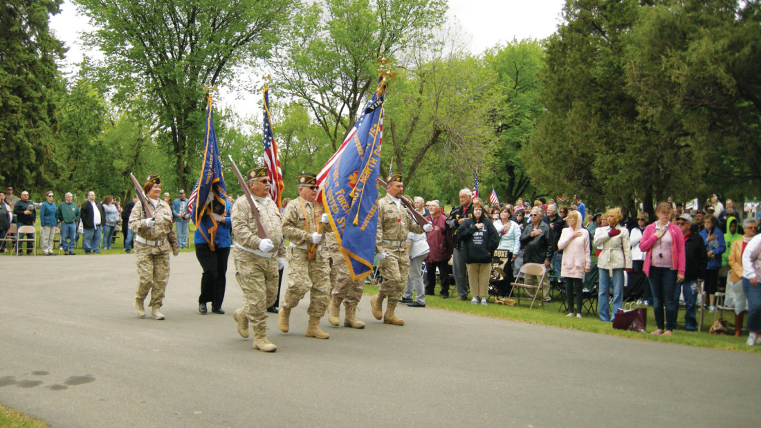 Andrea Johnson/MDN Minot Veterans organizations advance the colors during the Memorial Day Program Monday at Rosehill Cemetery.