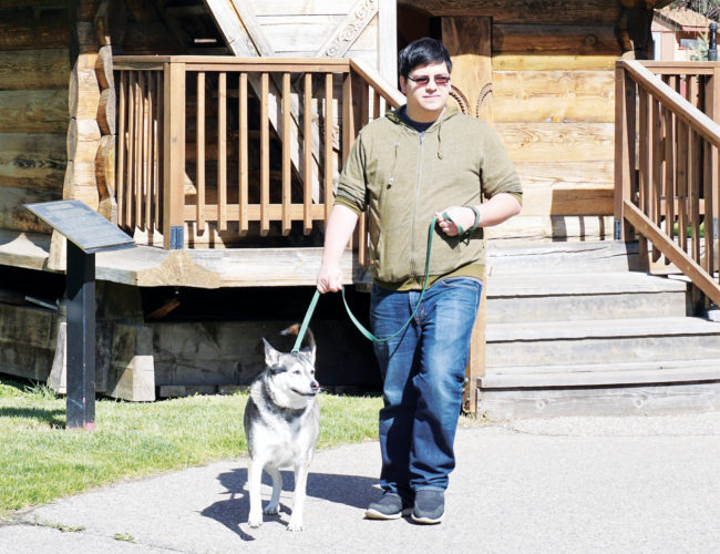 Jill Schramm/MDN Edward Montez walks with his dog, Kira, May 18 in the Scandinavian Heritage Park, which is near his home.