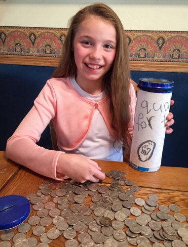 Leah Charley, 10, collected 1,344 quarters from family and friends over the past three years and donated the proceeds to Food For The Poor. The Minot, N.D., girl was stirred by images of starving children in the charity's mailings and wanted to come up with a way to help the poor. (Photo courtesy Charley family)