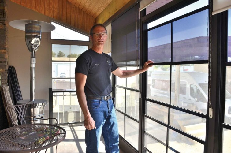 Eloise Ogden/MDN Dave Lebrun, president of Souris River Designs in Minot, shown in a sunroom model, said the location of a sunroom depends on the house and where it is situated, access to the sunroom and how it will be used.