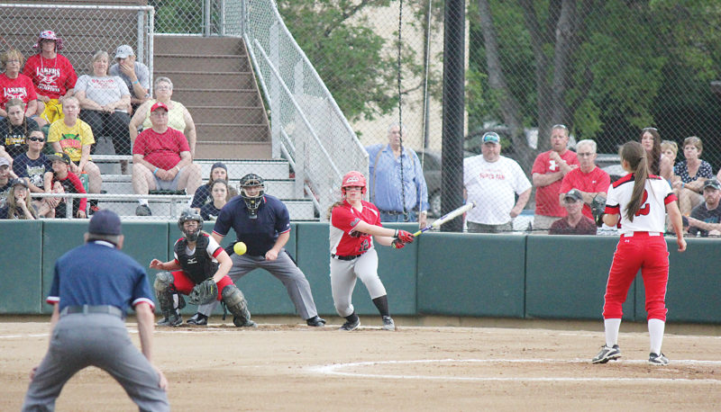 Alex Eisen/MDN Des Lacs-Burlington/Lewis & Clark senior Erica Moen (12) grounds out to first base, but brings in an RBI in a Class B state semifinal game against Central Cass. The Lakers lost 9-3.