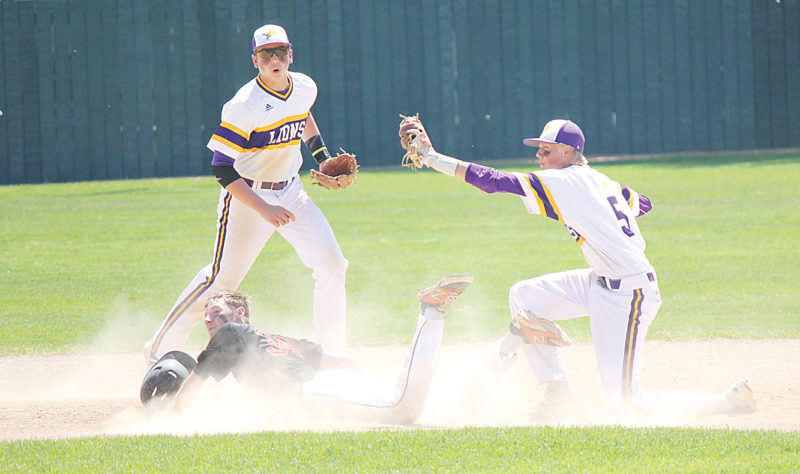 Alex Eisen/MDN Bishop Ryan's Mason Hedberg (5) tags out Rugby's Landon Foster (34) at second base with Eli Stewart watching on in a Class B state baseball contest on Friday at Jack Brown Stadium in Jamestown.