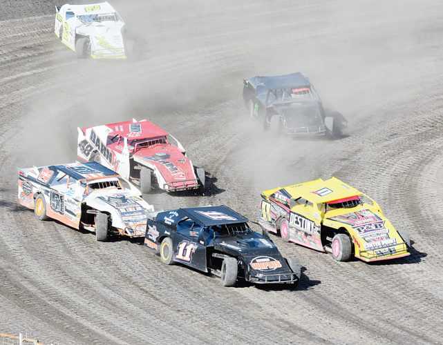 Various race cars fight for position during the Nodak Speedway races on Sunday in Minot.  Garrick Hodge/MDN