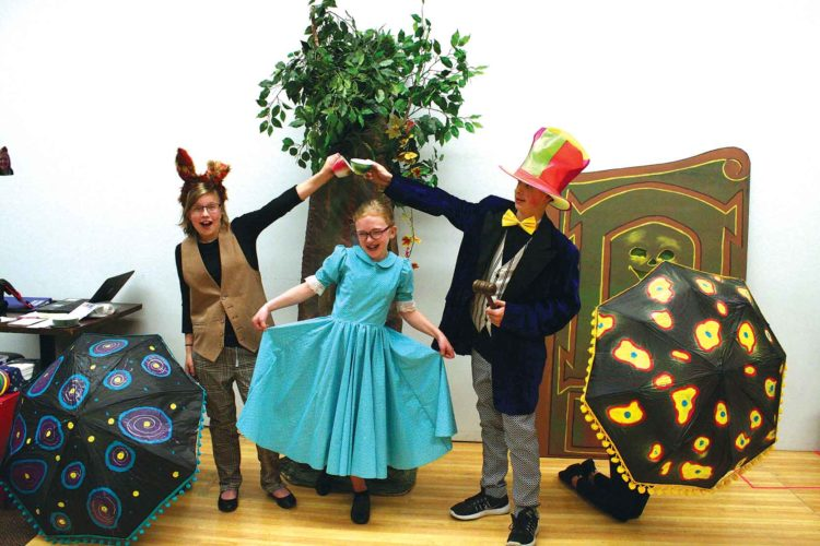 "Ruby Main, left, Lydia Repnow and Jaksyn Graham rehearse a scene from ""Alice in Wonderland.""  Submitted Photo"