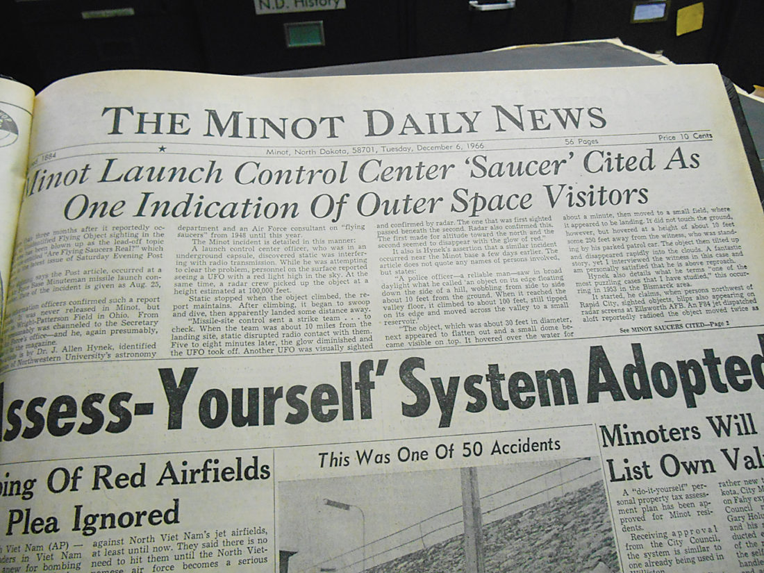 Eloise Ogden/MDN This photo shows the front page of the Minot Daily News on Dec. 6, 1966, when the newspaper ran a story about unidentified flying objects seen in the local area.