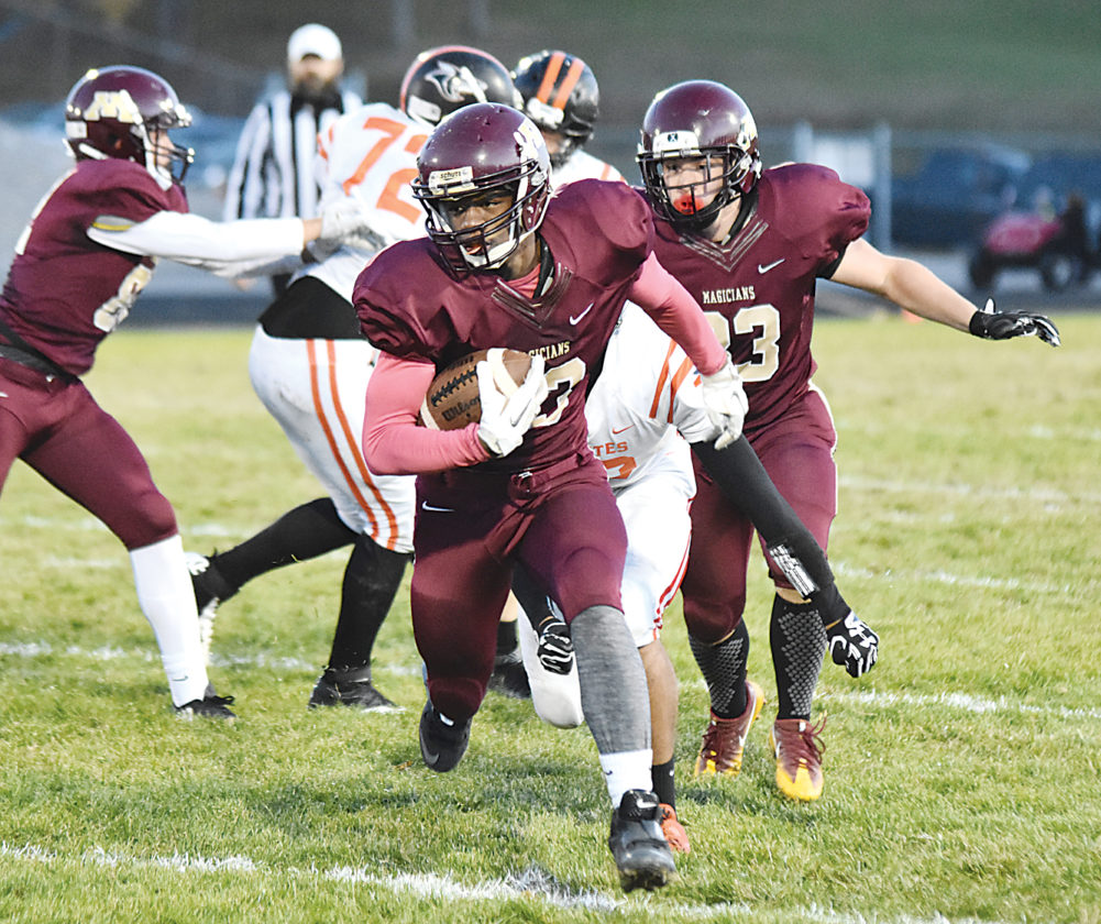 Garrick Hodge/MDN Minot High senior Manuel Bradford carries the ball in a West Region contest against Dickinson last year at Duane Carlson Stadium.