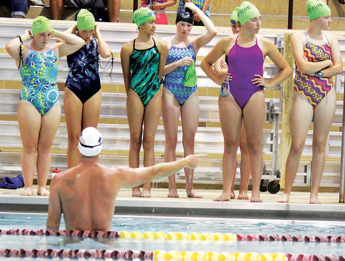 Alex Eisen/MDN  United States Olympic swimmer Jimmy Feigen directs the kids at the N.D. Elite Swim Camp on Saturday at Minot High School.