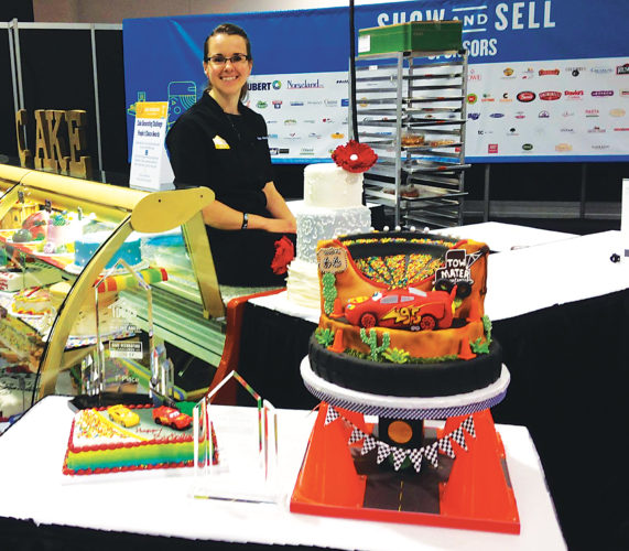 On June 6, Katie Knowles of Minot won first place at the IDDBA Competition at Anaheim, Calif. Three women in the United States were chosen as finalists in the cake decorating competition. They spent three eight hour days decorating cakes. On Day one they each decorated 20 novelty cakes.  Day two they decorated a car cake for Pixar Disney Co., which sponsors CARS 3, a new movie just coming out. On Day three they decorated wedding cakes. Knowles graduated from Anamoose High School in 2003.  She is the cake manager at the Marketplace Foods Main on Broadway. She has been decorating cakes for 17 years.