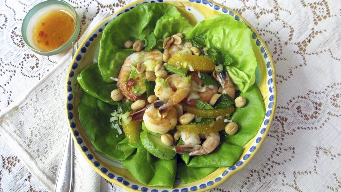 This June 15, 2017 photo shows a shrimp, avocado and orange salad with spicy orange dressing in New York. This dish is from a recipe by Sara Moulton. (Sara Moulton via AP)