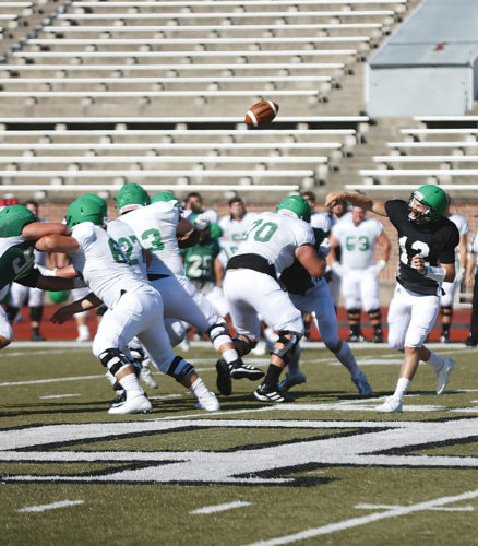 Submitted Photo Former UND quarterbackBen Bolinske attempts a pass during a college football practice last year. Photo courtesy of Matt Schill/UND Athletics.