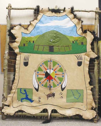 """SubmittedPhoto  Shantelle Carey's """"The Gift,"""" is a 7-foot-by-9-foot painting on a bison hide, featured in her exhibition """"An Individual Exploration of Spirituality."""""""