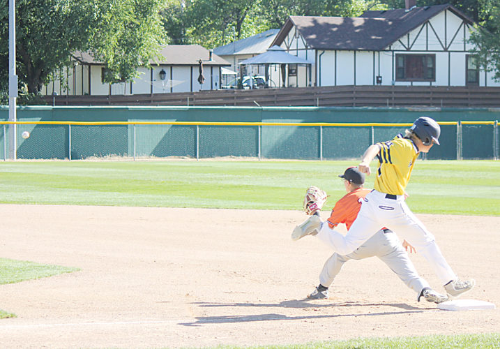 Alex Eisen/MDN Minot Metros' Jack Plemel beats out a throw to first base in the first game of a doubleheader against Williston on Wednesday at Corbett Field. The Metros won Game 1, 7-6, and lost Game 2, 11-1.