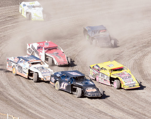 Garrick Hodge/MDN Various race cars fight for position during the Nodak Speedway races earlier this month in Minot.